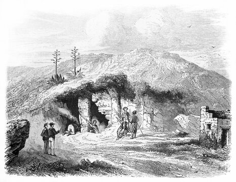 Cave of Antiparos entrance on a hilled mediterranean landscape, Cyclades islands, Greece. Ancient grey tone etching style art by Rouargue after Spoll, Le Tour du Monde, Paris, 1861