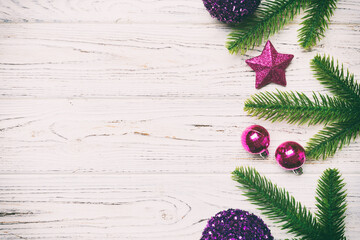 Wall Mural - Christmas composition made of fir tree, balls and different decorations on wooden background. Top view of New Year Advent concept with empty space for your design