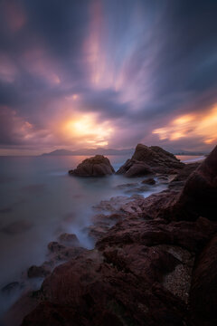 Epic cloudy sunset above the coastline of Cannes