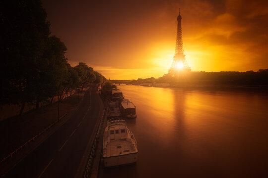 Epic sunrise behind the Eiffel Tower to Paris.
