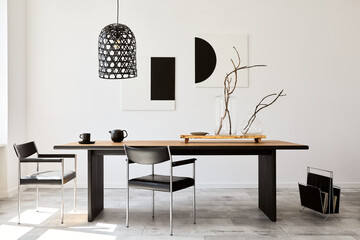 Photo sur Plexiglas Dinosaurs Stylish dining room interior with design wooden family table, black chairs, teapot with mug, mock up art paintings on the wall and elegant accessories in modern home decor. Template.