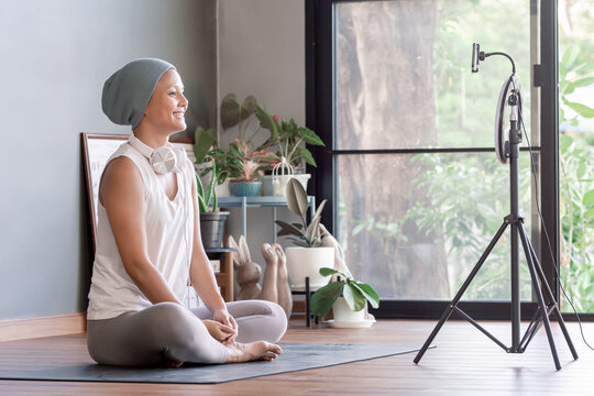 Asian cancer woman doing meditation and streaming online video