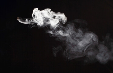 White flow smoke blot on black background.