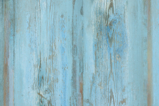Watercolor blue wood background. Light blue wood texture of pine board with knots. Blue washed wood texture. Wood table top view.