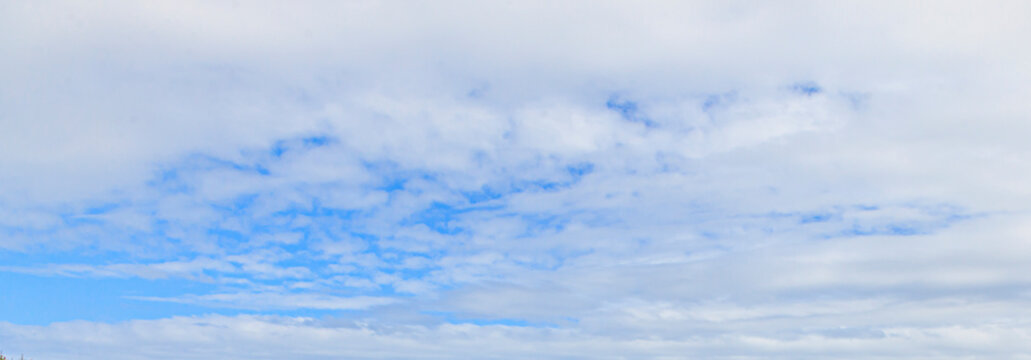 Image of a partly cloudy and partly clear sky during the day