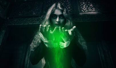 witch holding green magic dust