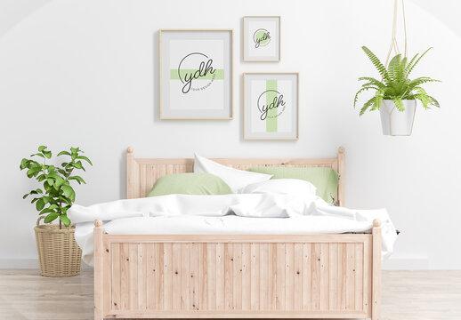 Three Vertical Wooden Frames Mockup Hanging in a Bedroom