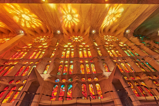 Sagrada de Familia with sun shining through led color stained wihdows. Famous cathedral created by Gaudi in Barcelona, Spain.