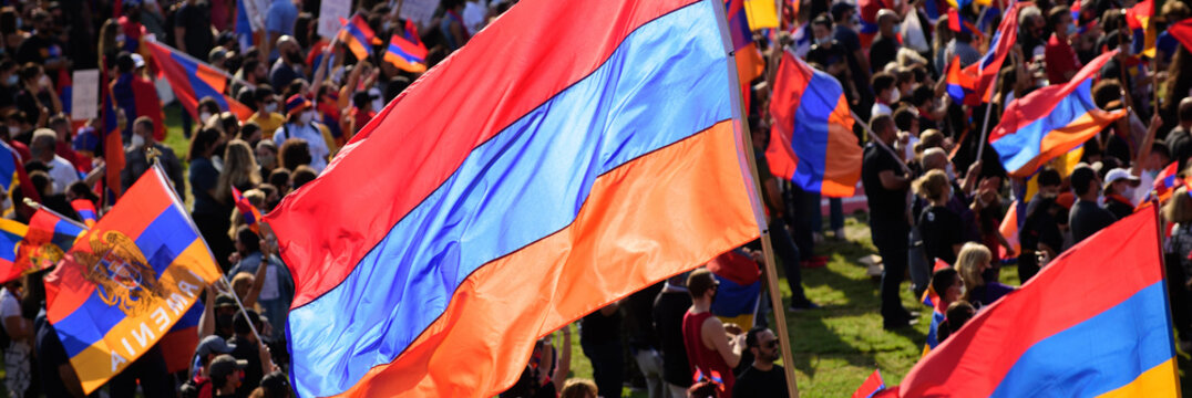 Armenian flags on the background of a demonstration of thousands of people.