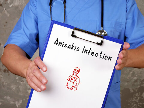 Medical concept about Anisakis Infection  with inscription on the sheet.