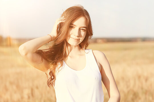 happy young adult model in yellow wheat field / summer happiness concept girl in the field