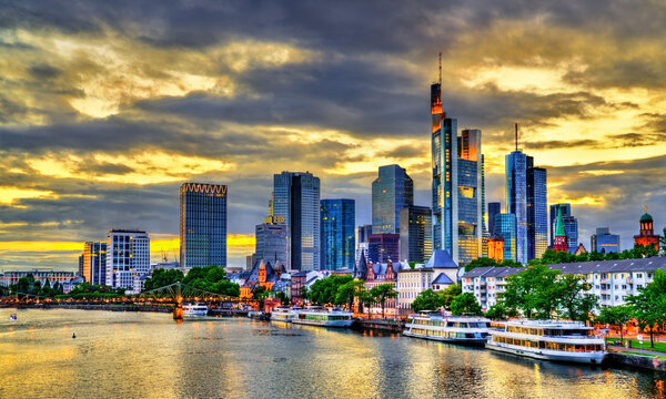 Sunset skyline of Frankfurt above the Main river in Germany
