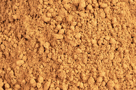 Heap of cacao powder background. Dark Cacao powder pattern. Pile of cocoa powder texture background
