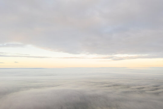 Aerial view white clouds. View from drone. Aerial top view cloudscape texture. Texture of clouds. View from above. Panorama clouds background