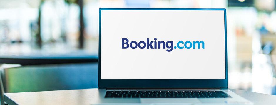 Laptop computer displaying logo of Booking.com