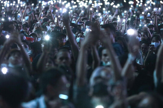 People use their mobile phones as flashlights during anti-government protests, in Bangkok