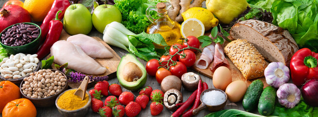 Composition with assorted organic food products on wooden table