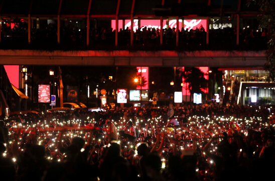 Pro-democracy protesters use their mobile phones as flashlights during anti-government protests in Bangkok