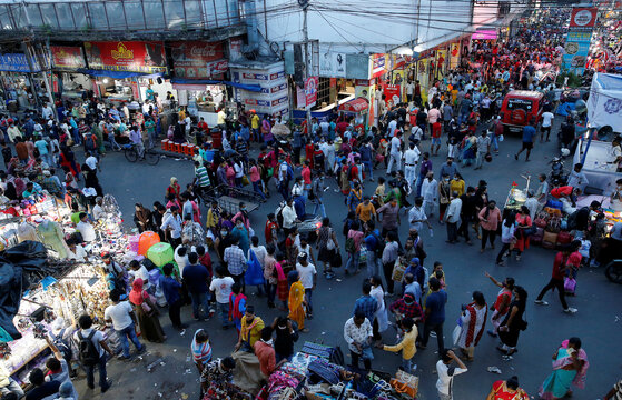 People throng a market to shop ahead of Durga Puja festival in Kolkata