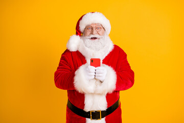 Portrait of his he nice cheerful cheery funny glad white-haired Santa using device app 5g shopping...