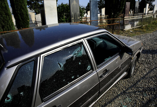 A damaged car is seen in a graveyard hit during the fighting over the breakaway region of Nagorno-Karabakh is seen in the city of Terter