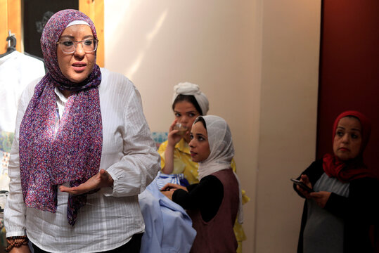 Designer Alabhar, looks on after showing a new clothes brand to disabilities and short stature at Kmt House in Cairo