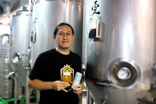 Kevin Chang, the factory manager of Zhangmen brewery, poses for a photo inside their beer production room in Taipei,