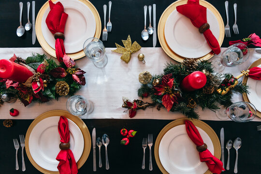 Overhead view of holiday Christmas dinner table setting