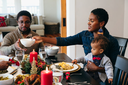 Family eating holiday meal together with child