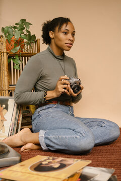 Black female photographer using vintage camera