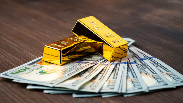 gold bar on dollar bills, Investing in real gold than gold bullion. Money and Gold, Financial concept