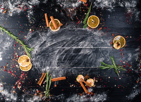 food background black with space for text with dried oranges and cinnamon