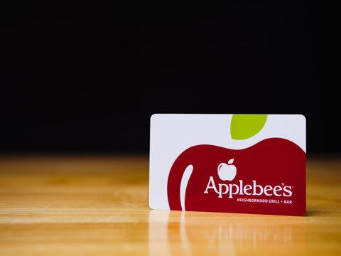 ATLANTA, GEORGIA - OCTOBER 15, 2020 : Applebee's gift card. Applebee's Neighborhood Grill + Bar is an American casual dining restaurant chain.
