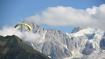 Wall Mural - Paraglider Flying with Scenic Mountains Vista. Slow Motion Footage. Chamonix Mont Blanc