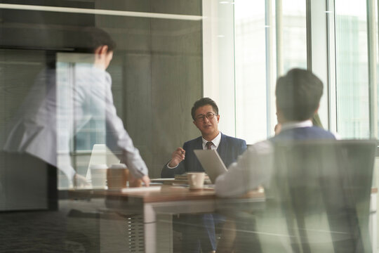 asian corporate executives meeting in conference room