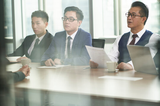 asian HR people conducting interview in meeting room