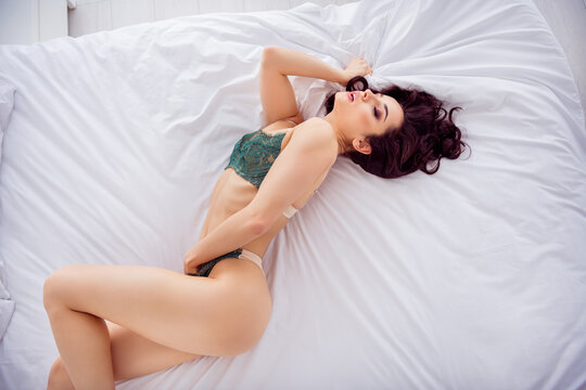 Top above high angle view portrait of her she nice fit slim attractive lovable chic gorgeous stunning tender girl lying on white linen touching herself fingers in panties enjoying joy