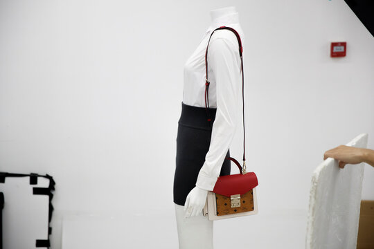 Mannequin wearing a handbag is seen during a photoshoot for the second-hand luxury goods retail platform Plum in Beijing