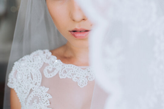 Close up photo of bride young woman with bright trendy lips.