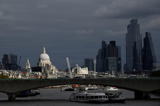St Paul's Cathedral is seen together with skyscrapers in the City of London financial district