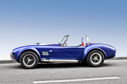 Kiev, Ukraine - April 11, 2014: AC Cobra. Luxury convertible car with clear sky background