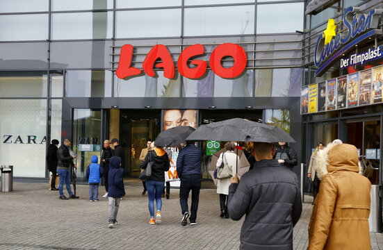People walk in front of LAGO shopping mall in Konstanz