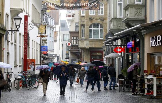 People walk in a shopping street in Konstanz