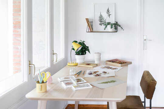 Creative material on wooden table at home