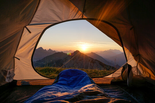 Tent pitched in Allgau Alps at sunset with Sulzspitze in background