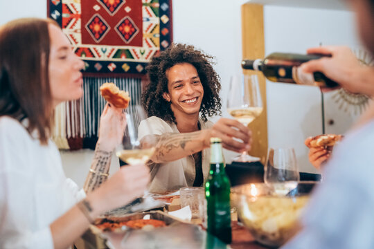 Happy man enjoying party with friends at home