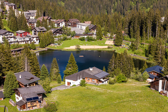 Switzerland, Canton of Grisons, Arosa, Town houses surrounding Untersee lake in summer