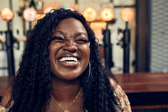 Portrait of a laughing woman in a pub