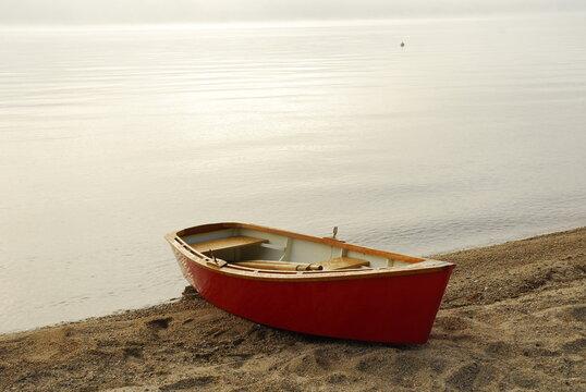 Boat moored along shore of Sebago Lake