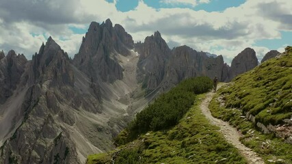 Wall Mural - Caucasian Hiker in His 40s on the Scenic Alpine Trail in the Italian Dolomites.